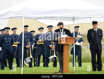 SAINTE-MARIE-DU-MONT, France (June 6, 2018) D-Day veteran Steve Melnikof speaks during the Utah Beach Federal Monument Ceremony. This year marks the 74th anniversary of Operation Overlord, the Allied invasion of Normandy on June 6, 1944 -- most commonly known as D-Day. An epic multinational amphibious and airborne operation, D-Day forged partnerships and reinforced transatlantic bonds that remain strong today. Overall, U.S. service members from 20 units in Europe and the U.S. participated in events and ceremonies May 30-June 7, 2018, in almost 40 locations throughout the Normandy region of Fra - Stock Photo
