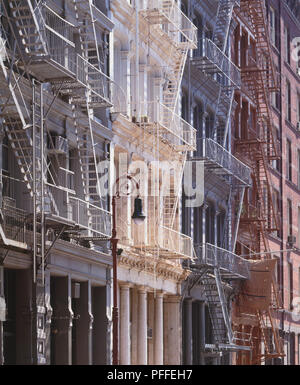 USA, New York, Lower Manhattan, late 19th century red, white and blue decorative cast iron facades on Greene Street. - Stock Photo