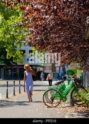 Bike sharing cycling rack hub dock during summer in Piacenza, Italy - Stock Photo