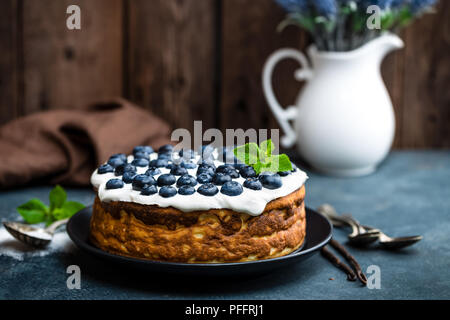 Blueberry cake with fresh berries and whipped cream, cheesecake - Stock Photo