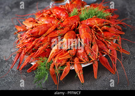 Crayfish. Red boiled crawfishes on table in rustic style, closeup. Lobster closeup. Border design - Stock Photo