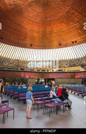 Temppeliaukio Church, view inside the Temppeliaukion Kirkko or 'Rock Church' in central Helsinki showing its huge 24m-diameter copper roof, Finland - Stock Photo