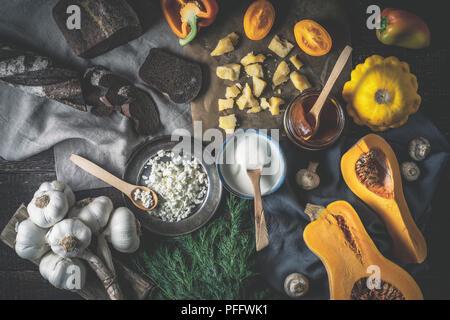 Different dairy products with vegetables on the wooden table top view - Stock Photo