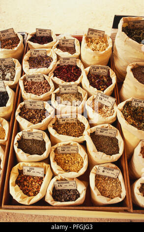 France, Provence, sacks of dried herbs on sale in a market stall, view from above. - Stock Photo
