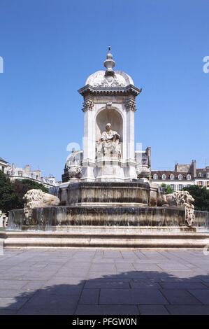 France, Paris, Place Saint-Sulpice, Fontaine des Quatre Points Cardinaux, a stone carved fountain. - Stock Photo