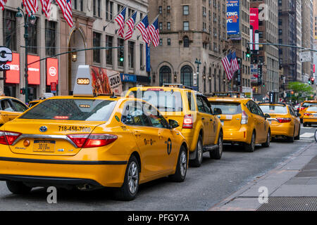 Yellow taxicabs in New York City - Stock Photo