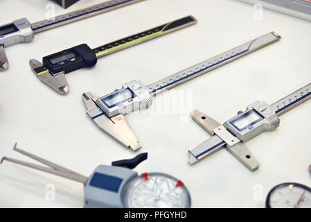 Digital calipers on white background in store - Stock Photo