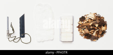 Wood chips, metal blade, cotton wool, tablets - Stock Photo
