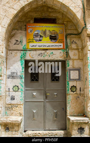 10 May 2018 A beautiful ornate doorway ito an islamic premises in the old city of Jerusalem Israel. Decorated with various Islamic symbols - Stock Photo