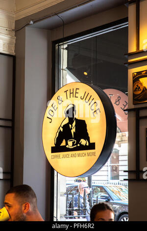 Joe & the juice logo in one of their shops. - Stock Photo
