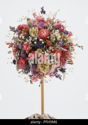 Dried flower tree with pink purple and white flowers - Stock Photo