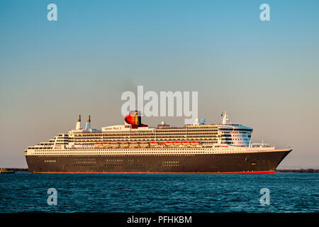 Adelaide, Australia - February 16, 2018: Cunard Line RMS Queen Mary 2 with people on board departing for a cruise from Outer Harbour, Port Adelaide - Stock Photo