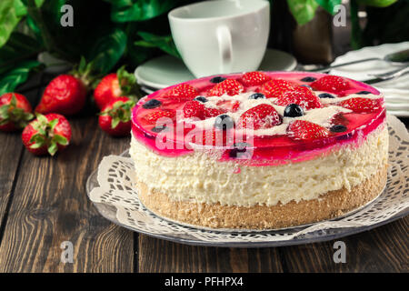 Cheesecake with strawberries, blueberry and jelly on a plate - Stock Photo