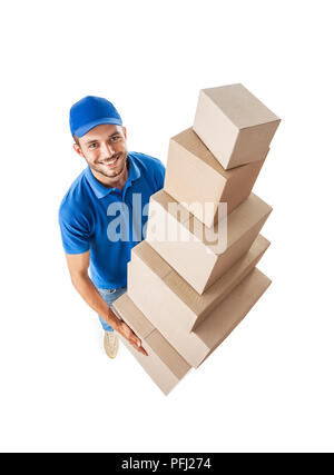 Top view of smiling express courier holding pile of cardboard boxes isolated on white background - Stock Photo