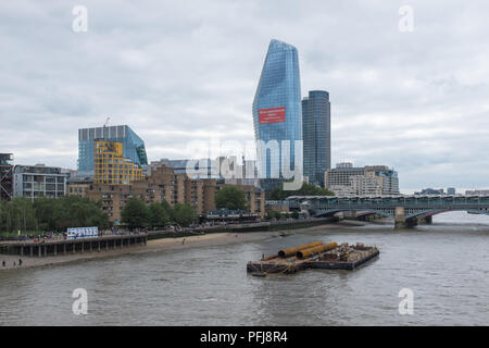 View looking west along River Thames from Millennium Bridge in London - Stock Photo