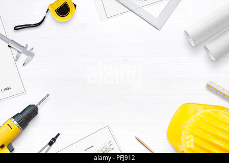 Preparations for renovation apartment or house. On the desk are projects and tools for measuring and drilling. Free space in the middle for text. Flat - Stock Photo