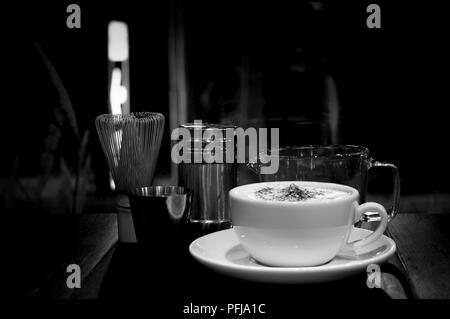 High contrast Coffee cup and measuring cup and coffee set in black and white - Stock Photo