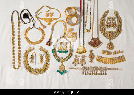 Head-to-toe adornment. Collection of traditional Indian jewellery, including necklaces, bangles and earrings - Stock Photo