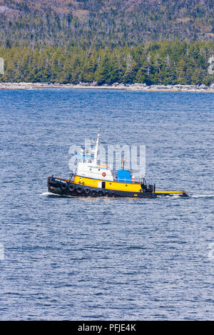 The ocean tug boat Western Mariner on the NW Pacific coast off Campania Island, British Columbia, Canada - Viewed from a cruise ship sailing the Insid - Stock Photo