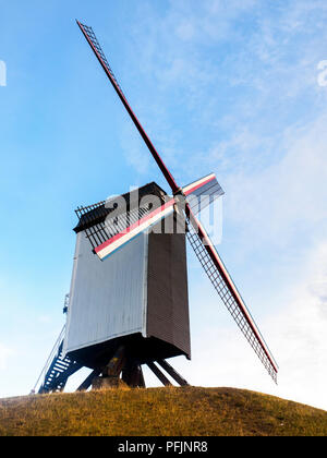 Sint-Janshuismolen windmill grinding grain in its original location since 1770 - Bruges, Belgium - Stock Photo