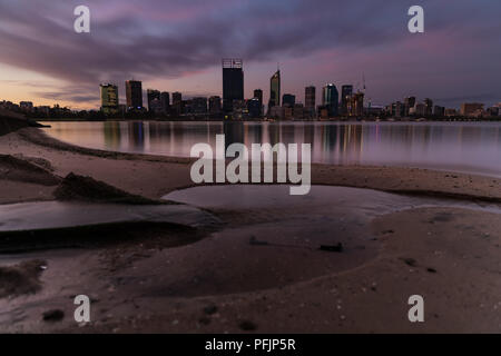 Sunset over the Swan river and Perth city Western Australia - Stock Photo