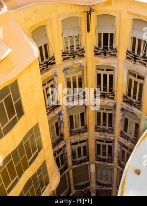 Former offices and apartments at Antoni Gaudi's La Pedrera - Casa Milà, Barcelona, Catalonia, Spain. - Stock Photo