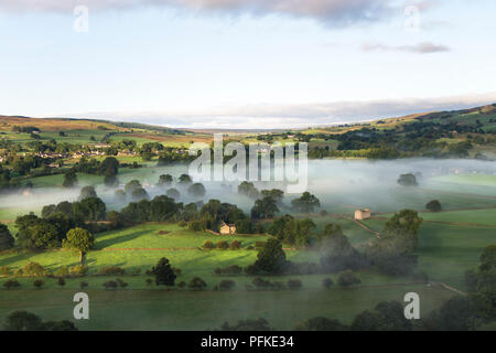 The View Over a Misty Tees Valley Towards the Village of Mickleton and Beyond into Lunedale from Whistle Crag, Middleton-in-Teesdale, County Durham, U - Stock Photo