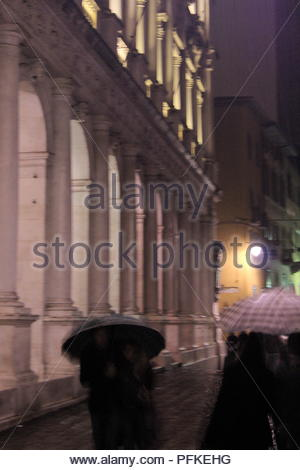 The lovely medieval upper town in Bergamo, Lombardy, Italy.  A winters evening with constant rain cannot detract from the beauty. - Stock Photo