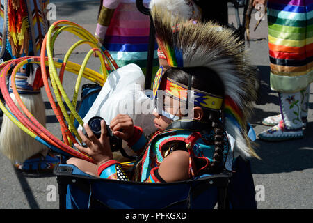 A young Native-American boy wearing traditional Plains Indian regalia at the Santa Fe Indian Market. - Stock Photo