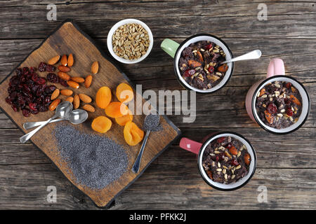delicious christmas dessert of poppy seeds mixed with dried fruits and nuts served in cups - traditional eastern europe holiday dish, horizontal view  - Stock Photo