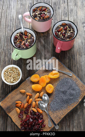 delicious christmas dessert of poppy seeds mixed with cooked whole wheat, dried fruits and nuts served in cups - traditional eastern europe holiday di - Stock Photo