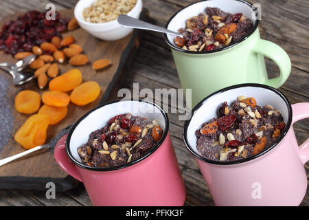 delicious christmas dessert or kutia of poppy seeds mixed with cooked whole wheat, dried fruits and nuts served in cups - traditional eastern europe h - Stock Photo