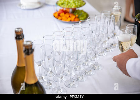 Empty Champagne Glasses on the table. event layout - Stock Photo