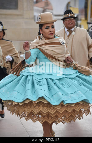 Potosi, Bolivia - July 26, 2018: Dancers in traditional dress parading through the city of Potosi, ahead of Bolivian Independence Day - Stock Photo