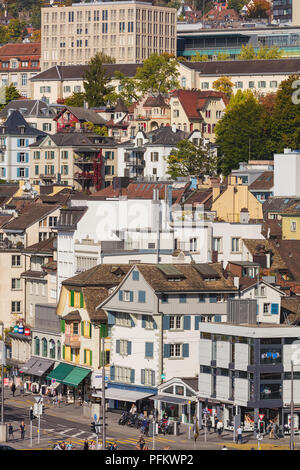 Zurich, Switzerland - September 27, 2017: buildings of the historic part of the city of Zurich along the Limmat river as seen from the Lindenhof park. - Stock Photo