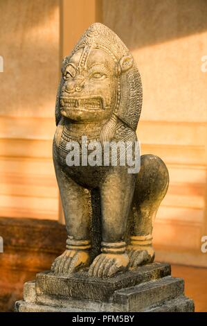 Thailand, Trat Province, Wat Plai Klong, also known as Wat Buppharam, stone lion - Stock Photo