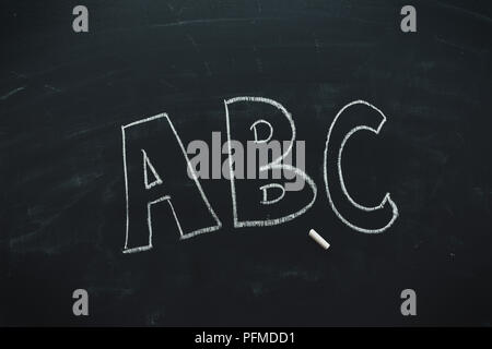 ABC on school blackboard written in chalk, education and literacy - Stock Photo