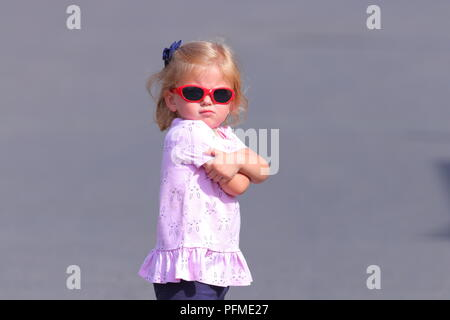 Little girl with an attitude - Stock Photo