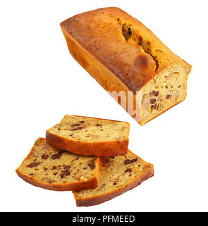close-up of freshly baked hot delicious banana bread sliced and isolated on white background, view from above - Stock Photo