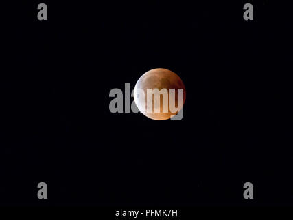 Full moon, blood moon in total lunar eclipse, 27.07.2018, Rosenheim, Bavaria, Germany - Stock Photo
