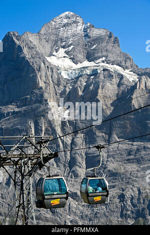 Cabin of the cable car Grindelwald-First in front of the Wetterhorn, Grindelwald, Bernese Oberland, Switzerland - Stock Photo