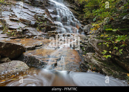 Silver Cascade in Hart's Location, New Hampshire during the autumn months. This waterfall is roadside along Route 302 in Crawford Notch State Park, an - Stock Photo