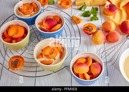 Ingredients for french dessert apricot clafoutis - Stock Photo