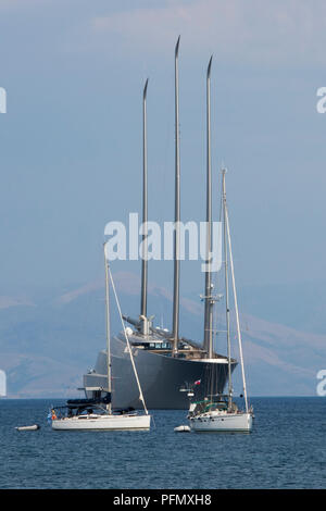 sailing yacht A moored or anchored in the bay off of Kerkyra in Corfu owned by Russian Billionaire Andrey Igorevich Melnichenko. - Stock Photo