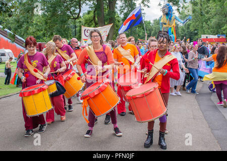 06.24.2017.Stoke on Trent,Uk.Drummers wearing colourful clothes on Lgbt pride event in Hanley park leading parade. - Stock Photo