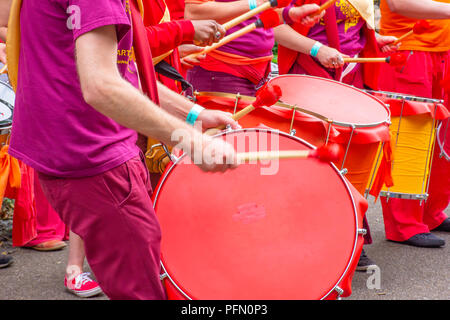 06.24.2017.Stoke on Trent,Uk.Drummers wearing colourful clothes on Lgbt pride event in Hanley park warming up festive atmosphere with rhythm.Community. - Stock Photo