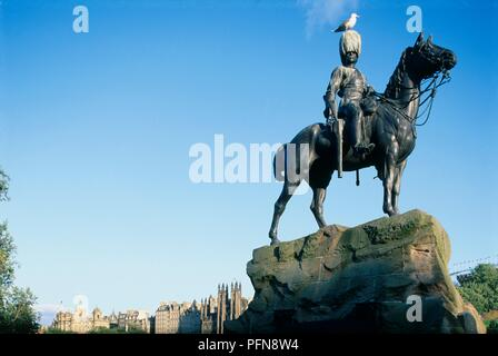 Great Britain, Scotland, Edinburgh, Princes Street Gardens, Royal Scots Greys Monument, equestrian statue with seagull perched on top - Stock Photo