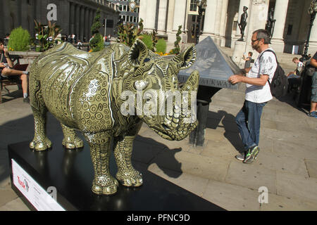 London, UK. 2 1 August 2018. A.D's Rhino Eterno painted by Adam Dant, outside the Royal Exchange, part of the 21 Tusk Rhino Trail installations on display in London. The rhinos, embellished by the internationally renowned artist will be on display until World Rhino Day on 22 September to raise awareness of the severe threat of poaching to the species' survival. They will then be auctioned by Christie's on 9 October to raise funds for the Tusk animal conservation charity. Credit: David Mbiyu / Alamy Live News - Stock Photo