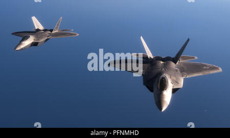 August 21, 2018 - Spangdahlem Air Base, Rheinland-Pfalz, Germany - U.S. Air Force F-22 Raptors from the 95th Fighter Squadron, 325th Fighter Wing, Tyndall Air Force Base, Fla., fly in formation after an air refueling over the Mediterranean Sea. After refueling, the F-22s trained with Spanish aircraft and landed at Los Llanos Air Base in Albacete, Spain where a pilot briefed the Raptor's capabilities to military and civilian personnel from NATO allied nations. Credit: U.S. Department Of Defense/Russian Look/ZUMA Wire/Alamy Live News - Stock Photo