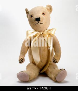 82bd15a1339 ... Teddy bear with yellow ribbon bow tied around neck - Stock Photo